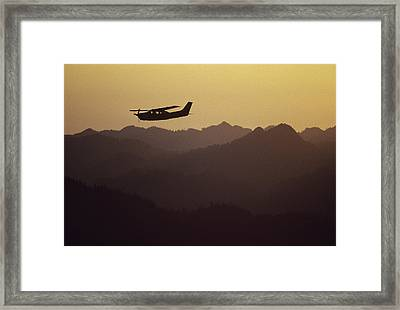 A Cessna 210 Soars Above Olympic Framed Print by Joel Sartore