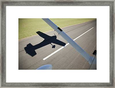 A Cessna Light Aircraft Taking Off The Shadow Tells The Story Framed Print