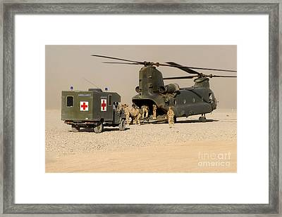 A Ch-47 Chinook Helicopter Drops Framed Print by Andrew Chittock