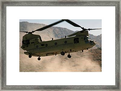 A Ch-47 Chinook Helicopter Kicks Framed Print