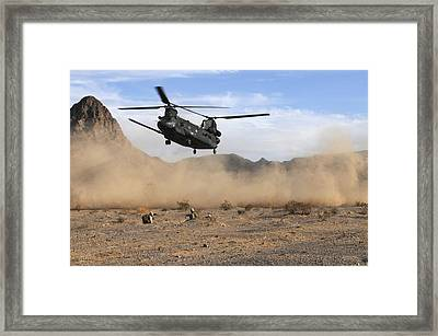 A Ch-47 Chinook Prepares To Land Framed Print