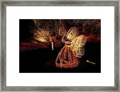 A Christmas Angel Comes To Life In This Framed Print