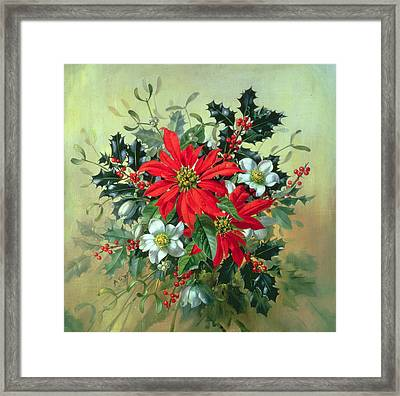 A Christmas Arrangement With Holly Mistletoe And Other Winter Flowers Framed Print