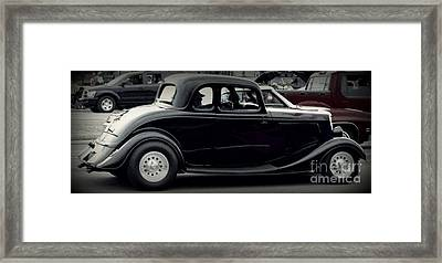A Classic In Motion Framed Print by Emily Kelley