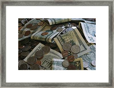 A Close View Of American Coin And Paper Framed Print by Joel Sartore