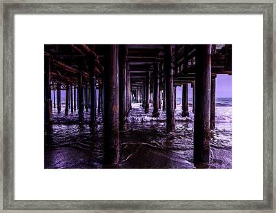 A Cloudy Day Under The Pier Framed Print