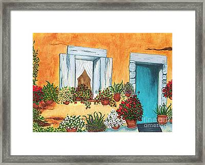 A Cottage In The Village Framed Print