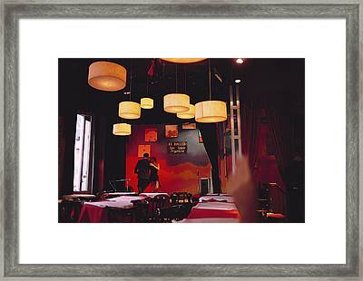 A Couple Dances The Tango At A Club Framed Print by Pablo Corral Vega