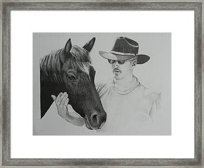 A Cowboy And His Horse Framed Print by David Ackerson