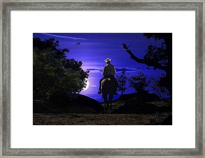 A Cowboy Riding A Horse On A Mountain Trail Into The Night. Framed Print by Peter Nowell