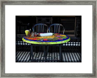 A Cozy Table For Two Framed Print