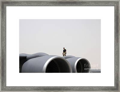A Crew Chief Walks The Wing Of A Kc-135 Framed Print