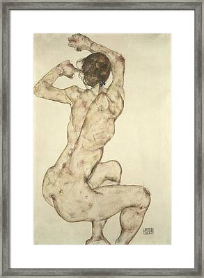 A Crouching Nude Framed Print by Egon Schiele