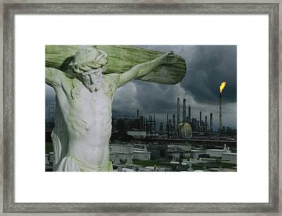 A Crucifixion Statue In A Cemetery Framed Print by Joel Sartore