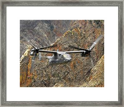 A Cv-22 Osprey Flies Over The Canyons Framed Print by Stocktrek Images