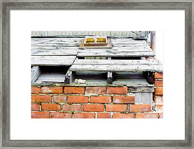 A Damaged Roof Framed Print by Tom Gowanlock