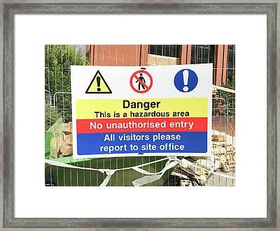 A Danger Sign Framed Print by Tom Gowanlock