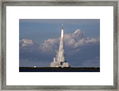 Framed Print featuring the photograph A Delta Iv Rocket Soars Into The Sky by Artistic Panda