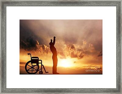 A Disabled Man Standing Up From Wheelchair Framed Print