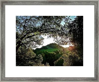 A Distant Cross Framed Print