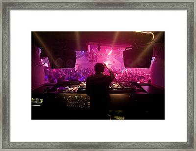 A Dj Plays To His Crowds On A Busy Framed Print by Justin Guariglia