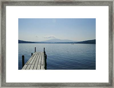 A Dock Juts Into The Framed Print by Stacy Gold