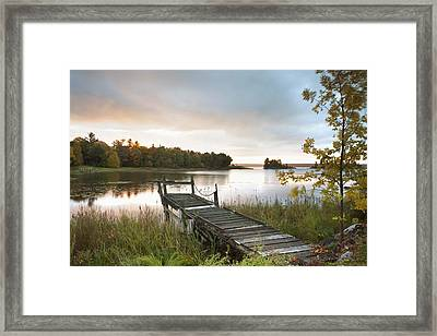 A Dock On A Lake At Sunrise Near Wawa Framed Print by Susan Dykstra