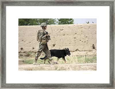 A Dog Handler Of The U.s. Marine Corps Framed Print by Stocktrek Images