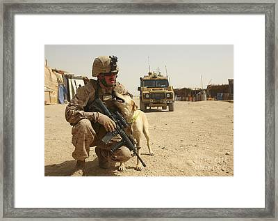 A Dog Handler Posts Security With An Framed Print by Stocktrek Images