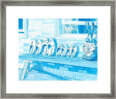 A Family Of Wooden Shoes  Framed Print