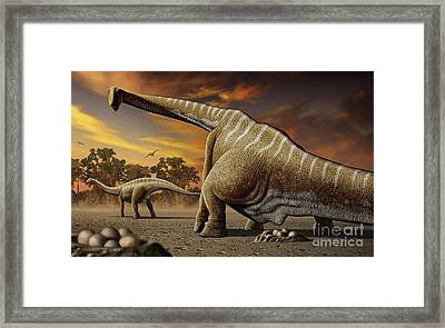 A Female Apatosaurus Laying Her Eggs Framed Print