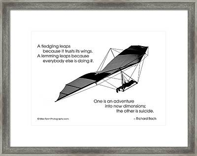 A Fledgling Leaps Framed Print by Mike Flynn