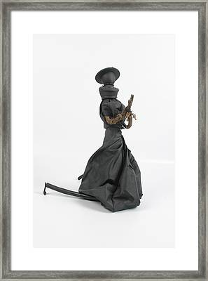 A Frayed Nun The Less Framed Print by Michael Jude Russo