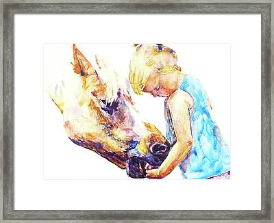 A Friendly Bribe Framed Print