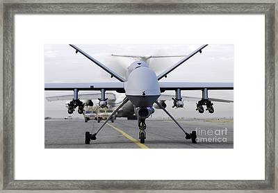 A Fully Armed Mq-9 Reaper Taxis Down An Framed Print