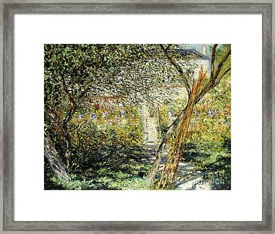 A Garden In Vetheuil Framed Print by Claude Monet