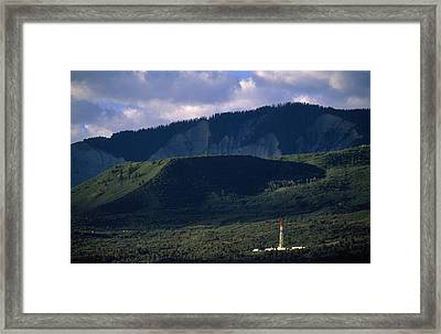A Gas Drilling Rig At The Foot Framed Print by Joel Sartore
