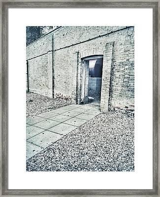 A Gateway In A Stone Wall Framed Print by Tom Gowanlock