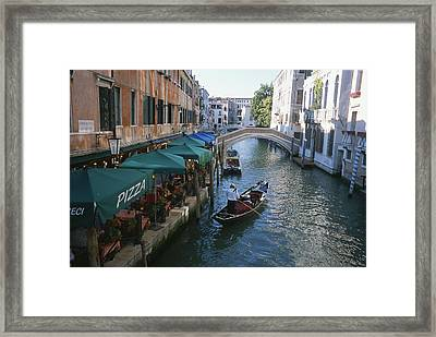A Gondolier Passes A Restaurant Framed Print by Taylor S. Kennedy