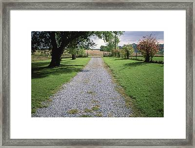 A Gravel Road Marks The Entranceexit Framed Print by Joel Sartore