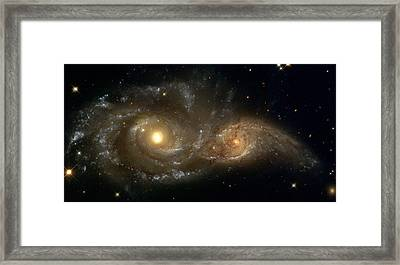 A Grazing Encounter Between Two Spiral Galaxies Framed Print