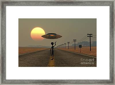 A Grey Alien Hitching A Ride Framed Print by Mark Stevenson