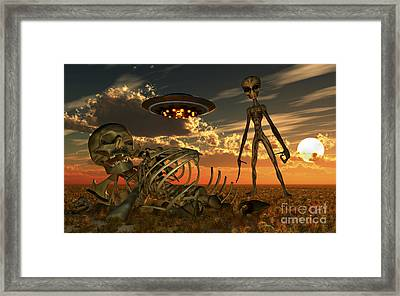 A Grey Alien Looking At Humanoid Framed Print