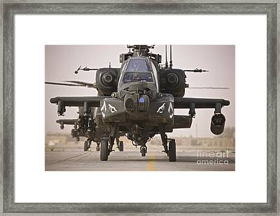 A Group Of Ah-64d Apache Helicopters Framed Print by Terry Moore