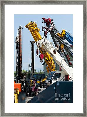 A Group Of Mobile Cranes. Hooks Framed Print