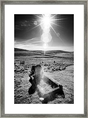 A Harsh Land Framed Print by Russ Brown