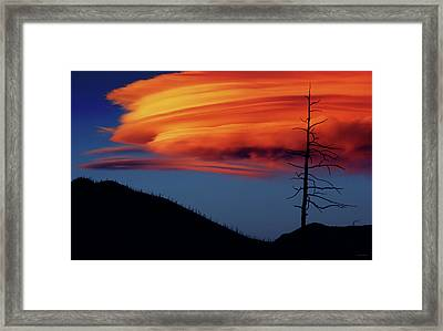 A Haunting Sunset Framed Print