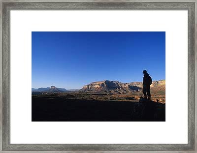 A Hiker Overlooks Tuckup Canyon Framed Print
