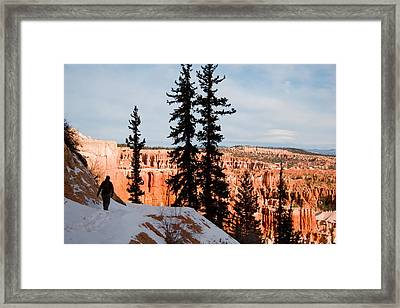 A Hiker Walks Along A Ledge In Winter Framed Print by Taylor S. Kennedy