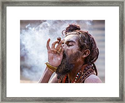 A Hindu Sadhu Smoking A Hash Pipe - India. Framed Print by Nila Newsom
